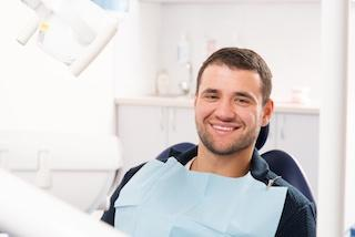 Man smiling in dental chair | Dentist Vallejo CA