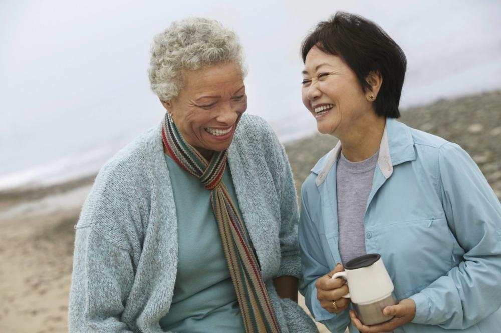 Two older woman standing on beach | Vallejo CA Dentist