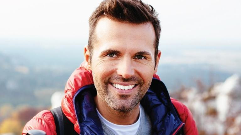 Man smiling on hike