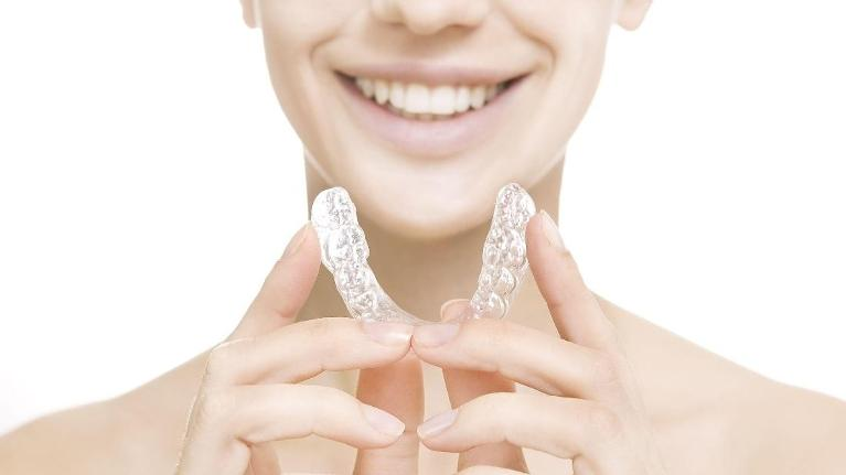 Woman holding Invisalign | Vallejo CA Dentist