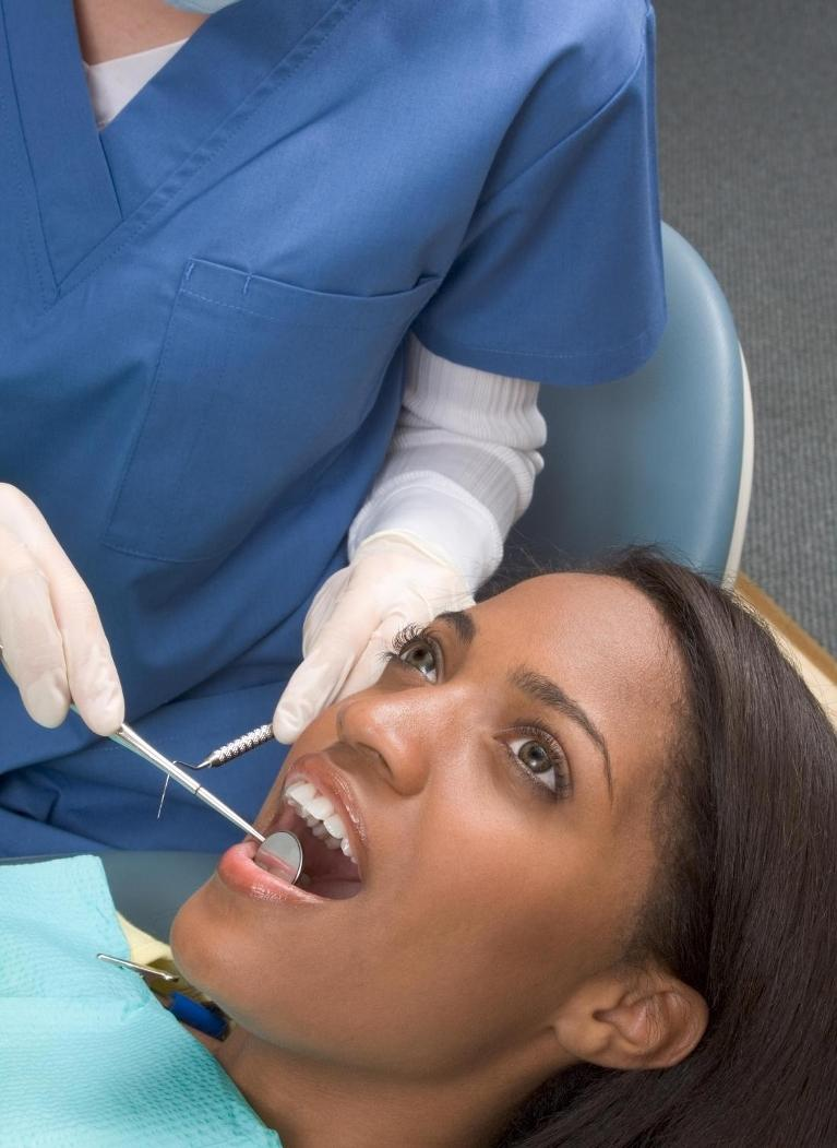 Woman receiving dental exam | Dentist Vallejo CA