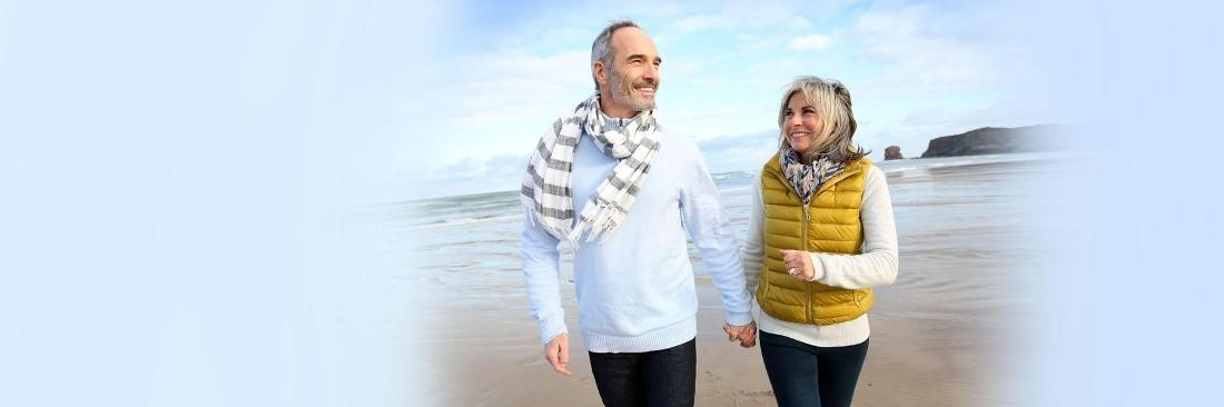 Man and Woman holding hands walking on beach | Dentist Vallejo CA